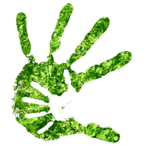 Conceptual hand print made of fresh green grass isolated